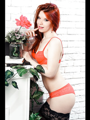 Redhead and young babe InnocentJasmin